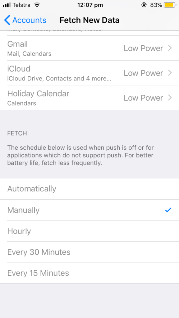 Screenshot of iPhone email account settings page showing 'fetch' schedule set to 'Manually'
